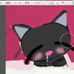 コタツの中で至福の時を過ごす黒猫の図