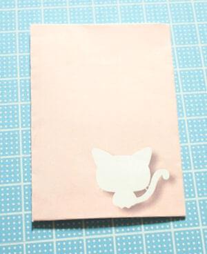 大人可愛いシルエット姿の猫ぽち袋(日本猫)